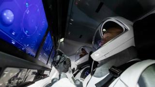 Astronauts in capsule