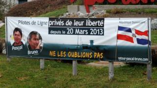 A banner showing support for Pascal Fauret and Bruno Odos is displayed in the French town of Autrans