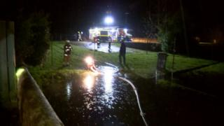 Firefighters pumping out water on Canal Road in Inverurie