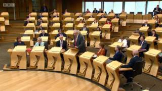 Mike Russell addressing MSPs