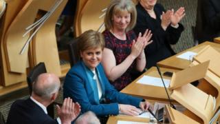 Nicola Sturgeon voted in as Scotland's first minister