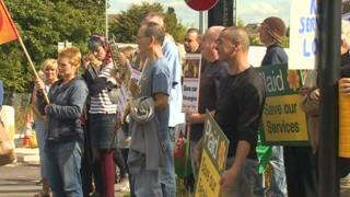 The protest was held on the day a new £15m fire and ambulance station was opened