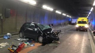 Photo from Cantonal Police Uri shows a traffic accident between a car and a truck in the Gotthard tunnel near the village of Hospental, Switzerland, 13 December 2017