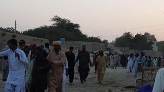 Pakistani devotees gather around the bodies of blast victims after a suicide bombing near a sufi shrine in Jhal Magsi October 5, 2017