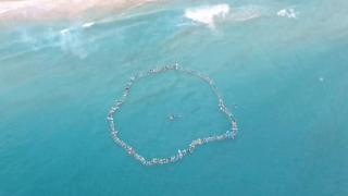"Australian photographer Lee Dunne captured this image of the ""paddle out"" on a drone"