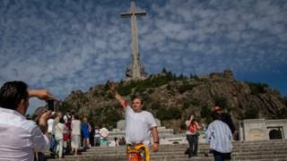 Franco supporter makes a salute at the entrance of the Valley of the Fallen
