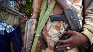 A file photo shows an armed fighter from the 3R armed militia displaying his weapon in the town of Koui, Central African Republic, 27 April 2017