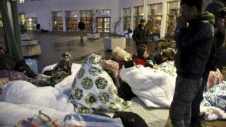 Refugees sleep outside an arrivals centre in Malmo, Sweden