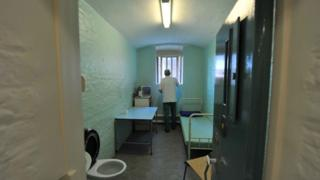 A prisoner in a cell