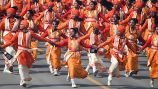 Schoolchildren dance on Rajpath during the Republic Day parade in New Delhi on 26 January 2020.