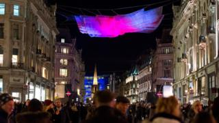 A London Lumiere installation by artist Janet Echelman is exhibited over Oxford Street during the Lumiere London exhibition