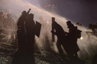 Police use a water cannon on protesters during a protest against plans to pass the Dakota Access pipeline near the Standing Rock