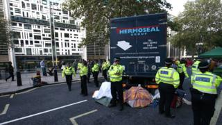A lorry blocks the road outside the Home Office