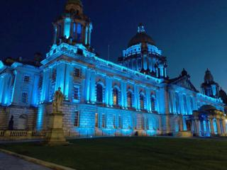 Belfast City Hall lit up in blue