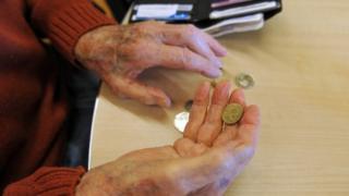 Elderly hands with money
