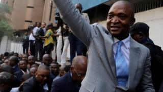 "Former Congolese interior minister Emmanuel Ramazani Shadary waves to his supporters as he arrives to file his candidacy for the presidential election, at the Congo""s electoral commission (CENI) head offices at the Gombe Municipality in Kinshasa, Democratic Republic of Congo, August 8, 2018."