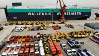 A shipment of vehicles prepares to leave for the UK