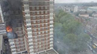 A fire rages in a flat in the Shepherd's Court tower block in west London