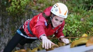 Duchess of Cambridge ascends a climbing wall as she visits the Towers Residential Outdoor Education Centre