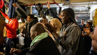 Migrants cheer to hear they can now disembark form the Sea Watch 3 ship, off Malta, on 9 January 2018