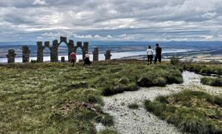 Students visiting the Cnoc Fyrish Monument