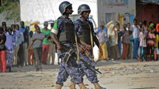 African Union Mission to Somalia (Amisom) soldiers patrol following a car bomb in Mogadishu - February 2015