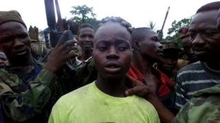 Government troops capture an 18-year-old rebel in Sierra Leone, 2000