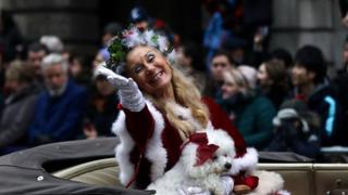 "A performer gestures as as she takes part in the New Year""s Day Parade"