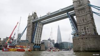 Boats passing under Tower Bridge