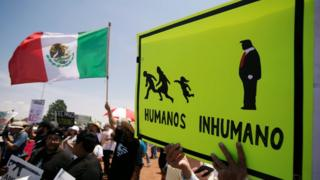 """Placard reads """"Humans and Inhuman"""", El Paso, 7 August"""