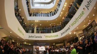 John Lewis and Waitrose staff clapping