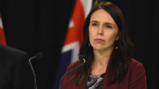 Jacinda Adern listens to a question at a press conference on August 6, 2018 in Wellington