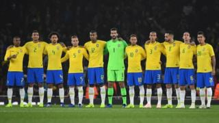 Brazil players hold a minutes silence ahead of their international friendly soccer match against Uruguay at Arsenal's Emirates Stadium in London, 16 November 2018.
