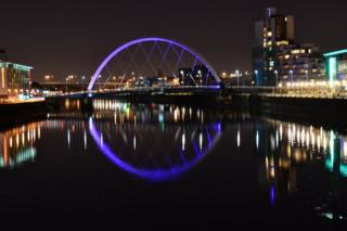 Glasgow skyline on Clyde at night