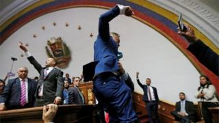 Opposition lawmakers enter the building of Venezuela's National Assembly in Caracas on 5 January, 2020.