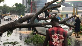Lagos heavy rain fall two buildings, trees and electric poles