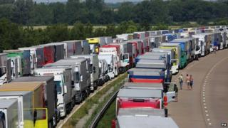 Lorries parked on both carriageways of the M20