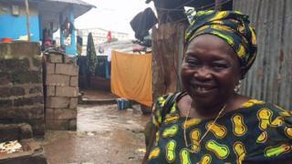 Memunatu Turay outside her home in Freetown