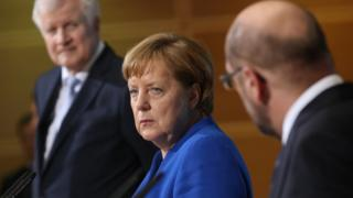German Chancellor and CDU head Angela Merkel with leader of the Bavarian Christian Democrats (CSU) Horst Seehofer and leader of the German Social Democrats (SPD) Martin Schulz on January 12, 2018 in Berlin, Germany