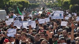 Algerians take part in a protest against ailing President Bouteflika's bid for a fifth term in power, in the capital Algiers on 1 March 2019