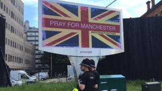 Billboard reading pray for Manchester
