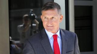 Michael Flynn, former National Security Advisor to President Donald Trump, leaves the courthouse following a pre-sentencing hearing in Washington DC, 10 July 2018