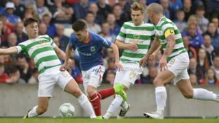 Linfield's Paul Smyth runs past Celtic players