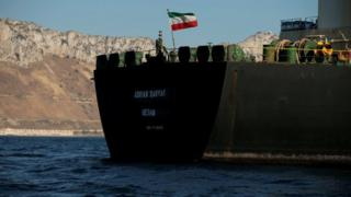 The Iranian flag flies on board the Iranian oil tanker Adrian Darya 1