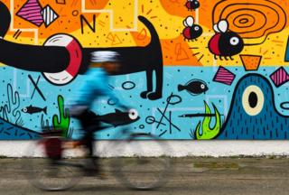Cyclist and mural