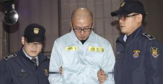 South Korean artistic director Cha Eun-taek, a key suspect in the influence-peddling scandal involving a close friend of South Korean President Park Geun-hye, is escorted after his arrest in Seoul, South Korea, on 12 November 2016.