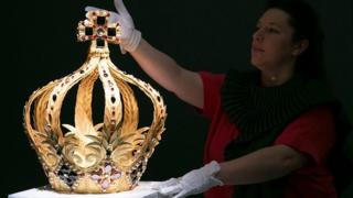 British Artist Zoe Bradley displays her paper sculpture crown at Sotheby's