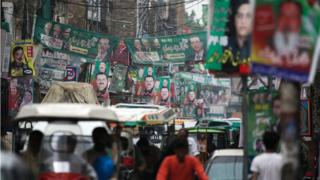 A street is decorated with flags and banners of political parties ahead of a general election in Rawalpindi, Pakistan, July 23, 2018