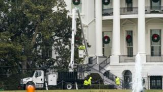 Workers prepare to remove the iconic Jackson Magnolia tree, the oldest tree on the White House grounds, from the South Lawn of the White House in Washington, DC, USA, 27 December 2017