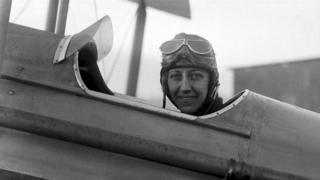 Amy Johnson sat in cockpit